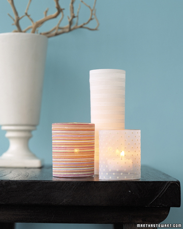 Candle slipcovers can easily be made by dressing a glass candleholder in a decorative fabric.