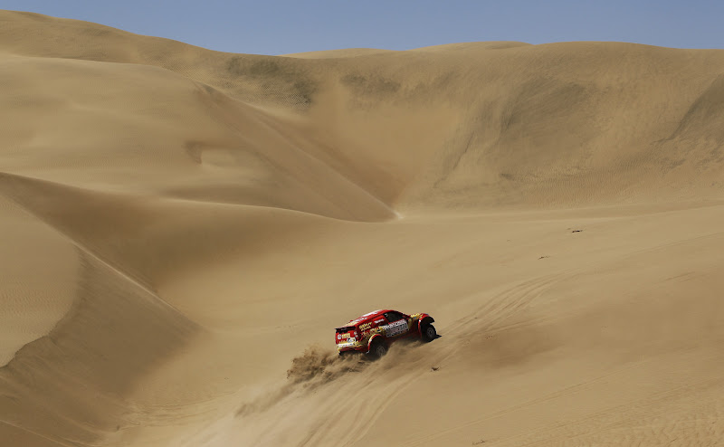 NASCA, PERU - JANUARY 13:  Carlos Sousa of Portugal drives through the sand dunes during stage twelve of the 2012 Dakar Rally from Arequipa to Nasca on January 13, 2012 in Nasca, Peru.  (Photo by Bryn Lennon/Getty Images)