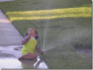 summer gio with sprinkler
