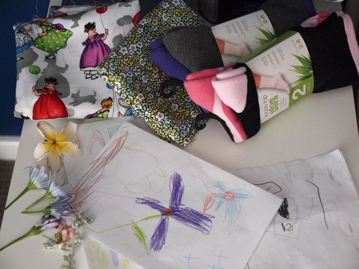hand made cards, socks wrapped in fabric and flowers and foliage picked from the garden