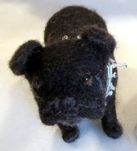 It looks a lot like you, Francesca!  If you send Jennifer a photo of your pet, she'll design a felted copy for you.  She constructs them out of wire frames and wool yarn.
