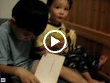 Kai reading to Eidan, with Eidan providing sound effects