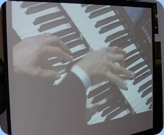 The hands of Hector Olivera on a Roland Atelier organ - shot taken from big screen and the perforance was shot from a video clip courtesy of Doug Farr