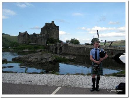 Piper at Eilean Donan castle.