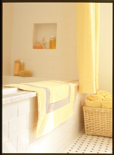 Built-in nooks around tubs and showers are made for holding soaps, shampoo and conditioner.  I like them much better that shower caddies.