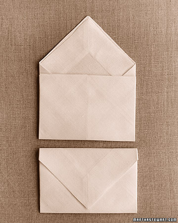 This simple design is among the easiest to do, and the folded napkins stack well. Treats or a place card can be tucked inside.