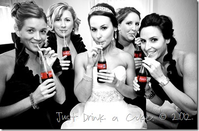 bride and bridesmaids drinking Cokes from a bottle