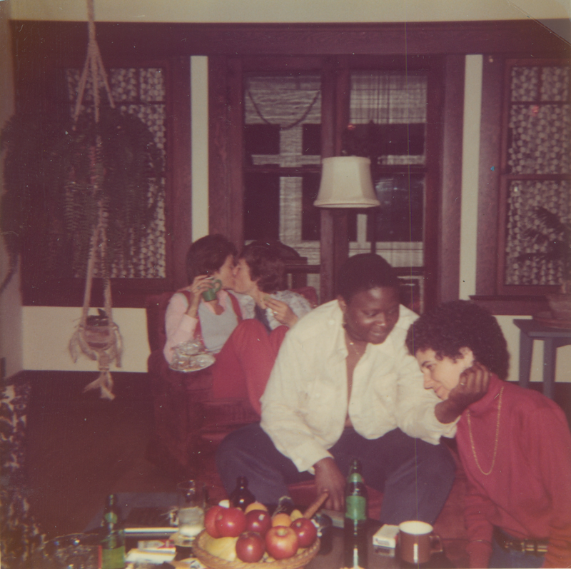 Rosalyn Allen and Maggie Konzen (couple at right). Lesbian couples at Christmas eve party at Brenda Weathers and Nicki Toomey's house. 1975