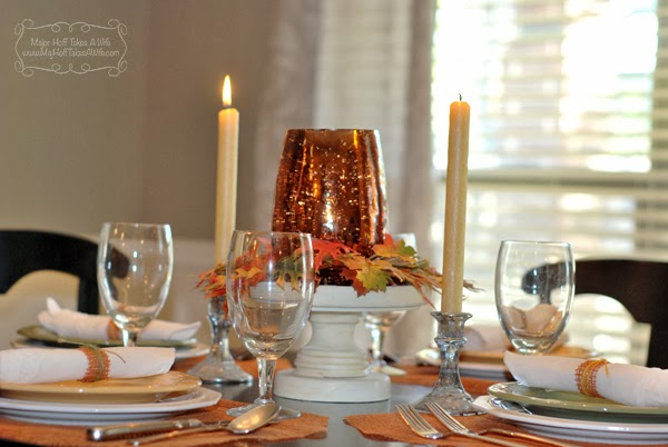 Fall centerpiece cake stand leaves candles