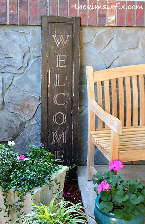 Vintage welcome sign on front step