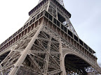 The Eiffel Tower, located on the Champ de Mars in Paris, is global cultural icon of France and one of the most typical structures in the world.
