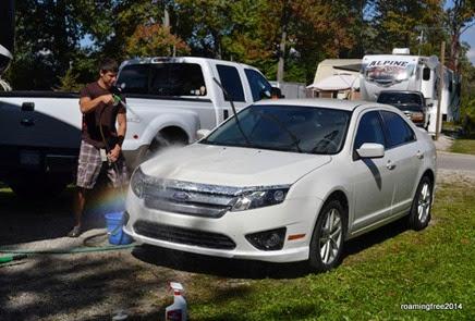 Nicolas washing his car