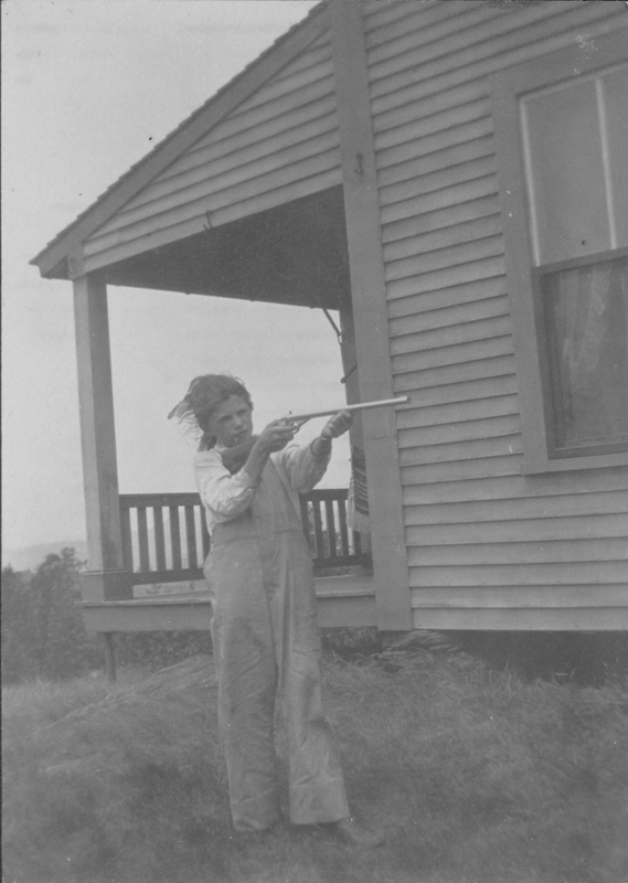 Dorothy Putnam as a youngster shooting a gun in Alstead, New Hampshire. Undated.