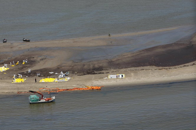Aerial view of workers involved in cleanup efforts of the Deepwater Horizon oil spill, with oily water around them near the South Pass of the Mississippi River along the Gulf coast near Venice, Louisiana, on Thursday, 27 May 2010. AP Photo / Gerald Herbert