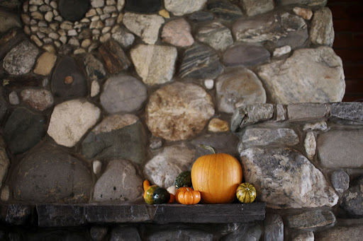 Fall pumpkins and gourds adorned the mantle to usher in the harvest feel of the season.