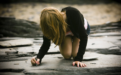 Girl Writing with Stone