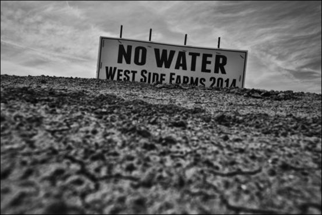 A sign over a dessicated California field reads, 'NO WATER - West Side Farms 2014'. Though this is the third year of drought, fieldworker Antonio Chavarrias believes it's just the beginning of the hardships. Photo: Michael Robinson Chavez / Los Angeles Times
