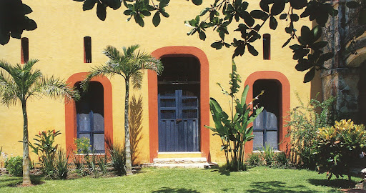 Refreshing color and exotic plants decorate the exterior of Casa Neuva.