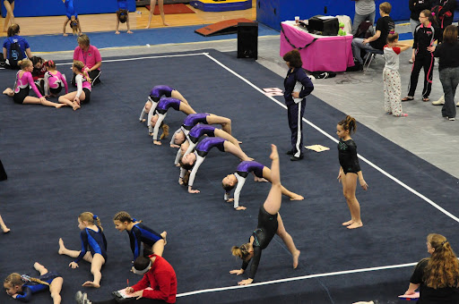 Level 4 team stretches for the meet