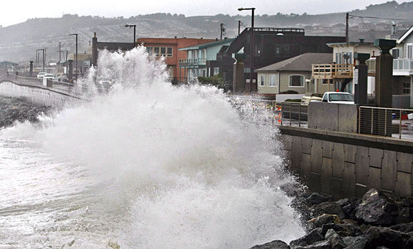 Waves pound a wall in Pacifica, California, during a January 2010 storm. A recent survey found that most Americans were no longer willing to accept a hands-off approach to continued coastal development that will get battered repeatedly by rising seas as the climate changes. Photo: Paul Sakuma / Associated Press