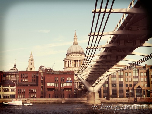 St. Paul's Cathedral &amp; Millenium Bridge seen from the River Thames.