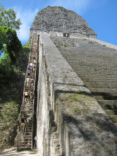 Steep wooden ladders up the side of a Temple at Tikal, Guatemala