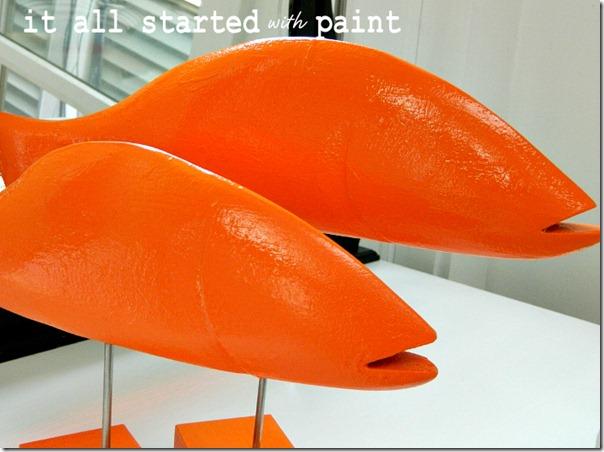fish_on_sticks_painted_bright_orange