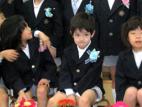 Kai waiting for the group photo to be taken at his kindergarten graduation