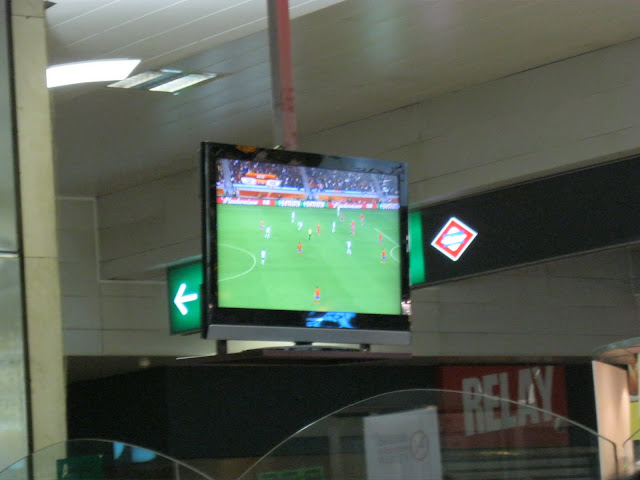 Watching the game at the station