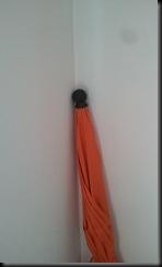 Der orange Sonnenschirm der Hölle