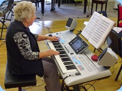 Barbara Powell playing the Tyros 4. Photo by Gordon Sutherland