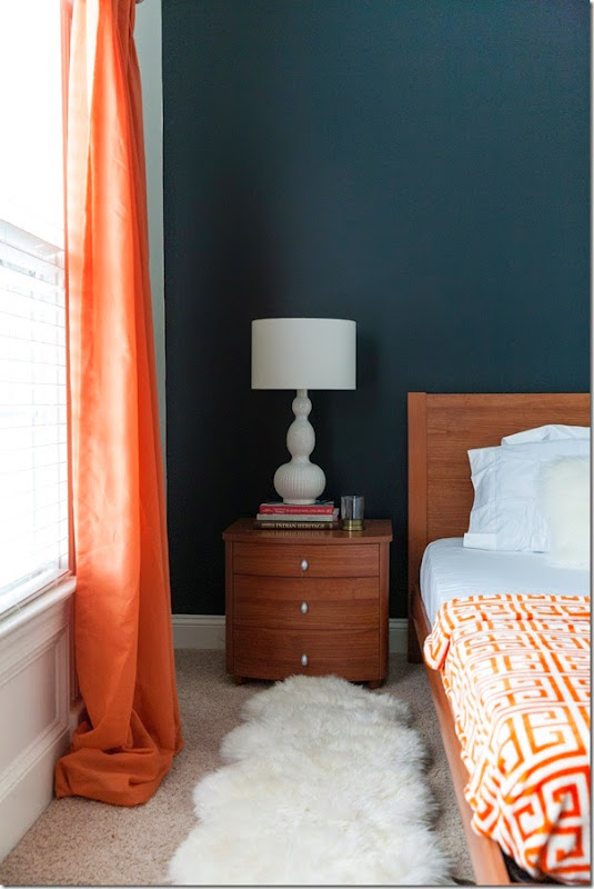 guest bedroom makeover with pops of my favorite color, orange