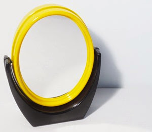 yellow and black swiveling vanity magnifying mirror front