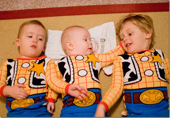 three boys in woody pjs
