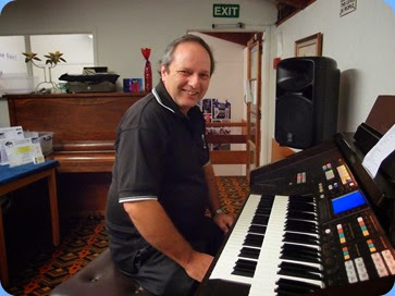 Doug Farr setting-up the Technics GA3 organ. Photo courtesy of Dennis Lyons