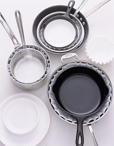 Most people don't think of protecting skillets, but these items need the same attention as fine china. By nesting pots and pans between large coffee filters and paper plates, you'll keep your saucepans scratch-free.