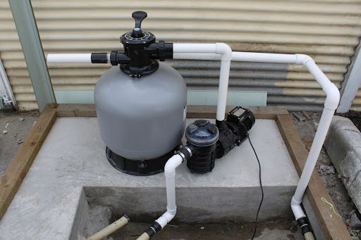Pump and filter all assembled and plumbed. The next step is to build the pump shed and then plumb the backwash into the drain at the back. The water you can see is from the unused vacuum hose on the left, not my plumbing. :)