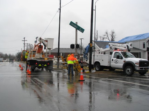 Crews work to repair traffic lights at the intersection of Cherokee Street and National Avenue in Springfield Wednesday.