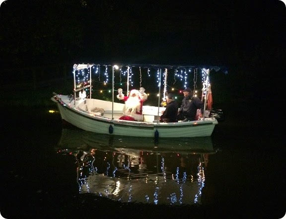 Father Christmas arrives via the Audlem Lass water  taxi