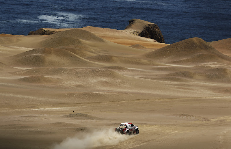 NASCA, PERU - JANUARY 13:  Giniel de Villiers of South Africa and Toyota drives over a sand dune during stage twelve of the 2012 Dakar Rally from Arequipa to Nasca on January 13, 2012 in Nasca, Peru.  (Photo by Bryn Lennon/Getty Images)