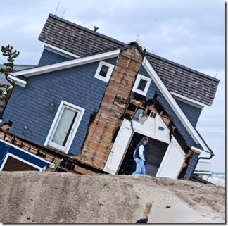 Sandy - Tilting house on beach in Mantoloking - April Saul  - Inquirer Staff Photographer