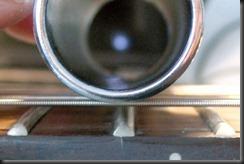 slide bottleneck botella metal ceramica