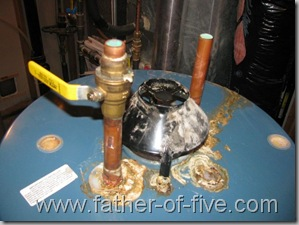 Boil-over?  Old water heater with severed supply lines