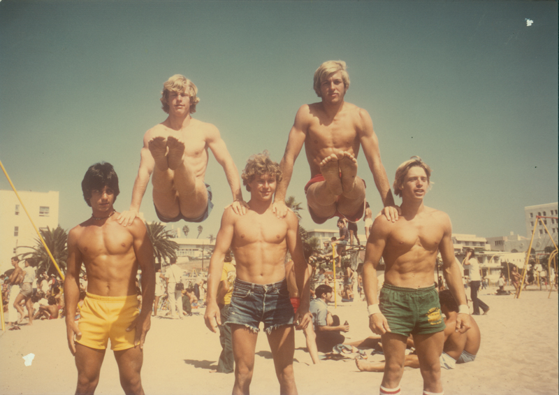 Five shirtless men pose at the Santa Monica Gymfest. September 1975.