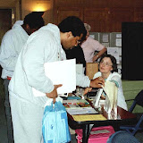 Carol Barnett shares info at RAVS table at SUNY Brockport health fair. May 2005
