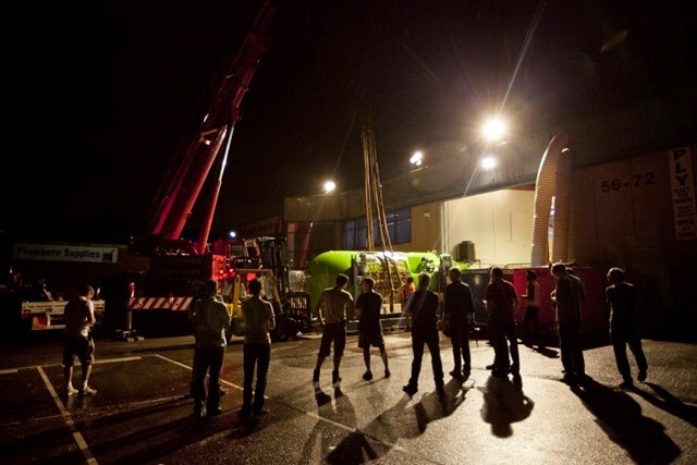 Acheron employees watch as the submersible is lifted onto a flatbed truck at Acheron Project offices, Sydney, Australia.  Allum is managing director of the Aceron Project and designer of the sub.
