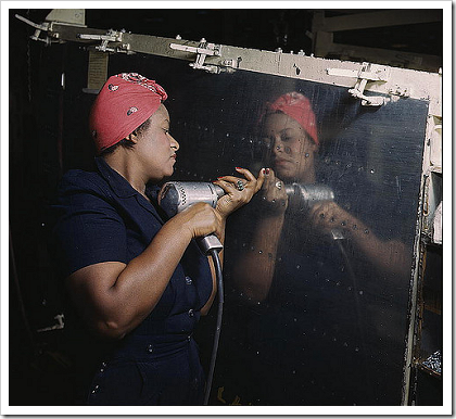 Woman working on a dive bomber (1943)