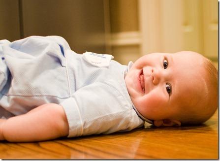 B laying on ground smiling