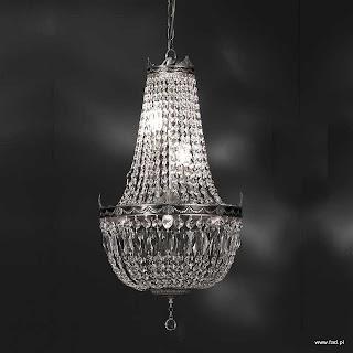 Żyrandol z kryształami. Wykończenie: nikiel. Wys 740 mm, Szer 420 mm, Światło 6 x 40W E14 typu świeca.