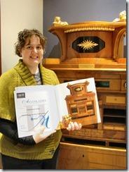 Emily Wass holds award